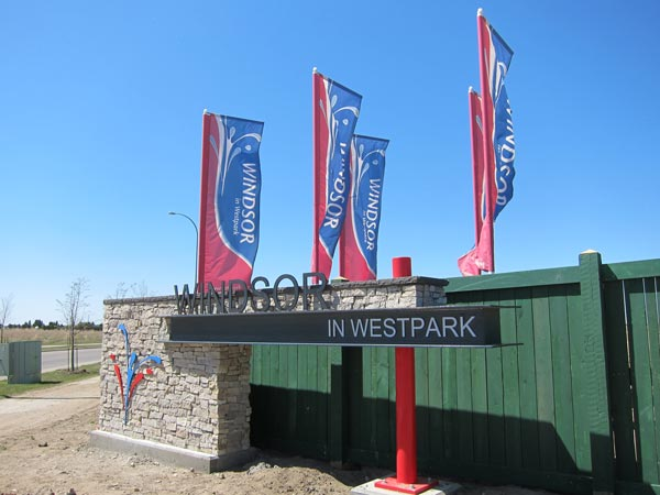 Flags at entrance of new Fort Saskatchewan development