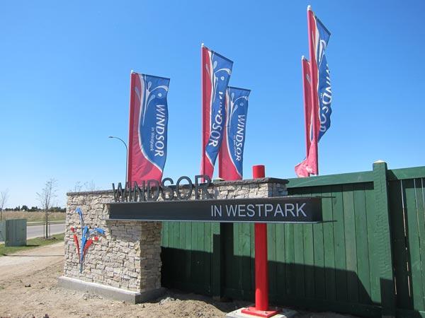 Flags at entrance of new Fort Saskatchewan development