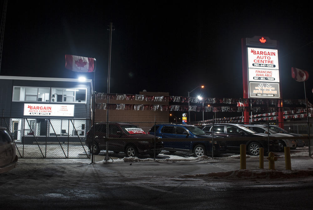 Night photo of sign cabinet and pylon sign