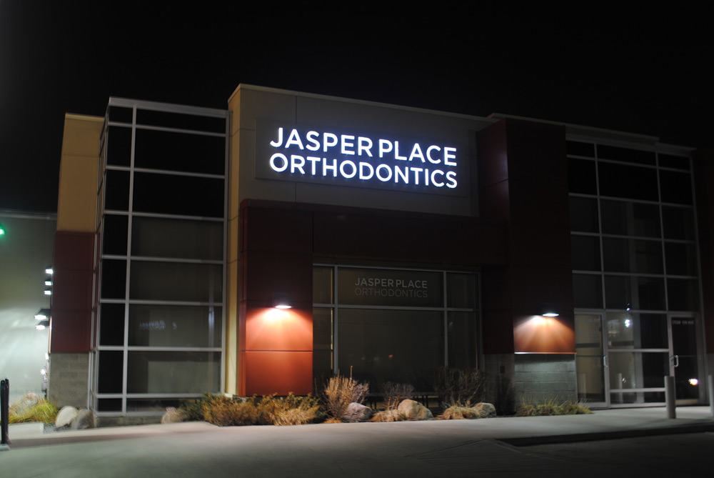 Night shot of Edmonton sign for Jasper Place Orthodonics