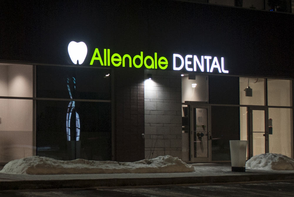 Night shot of shaped channel logo, Allendale Dental