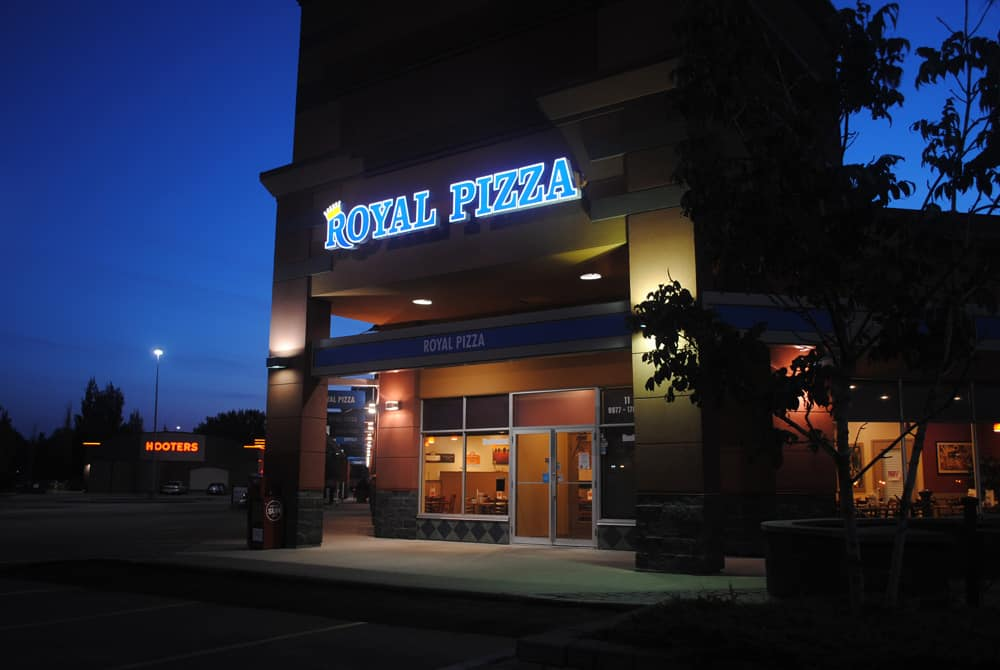 Royal Pizza backlit sign - night view