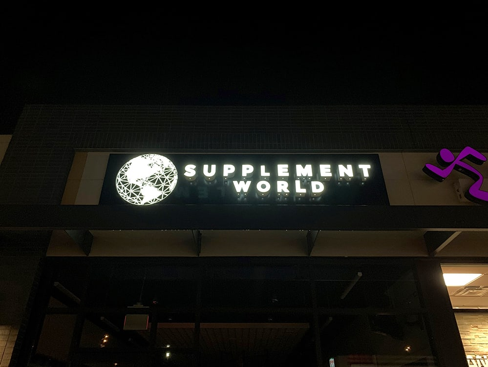 Night view of channel letters at Supplement World location in Edmonton